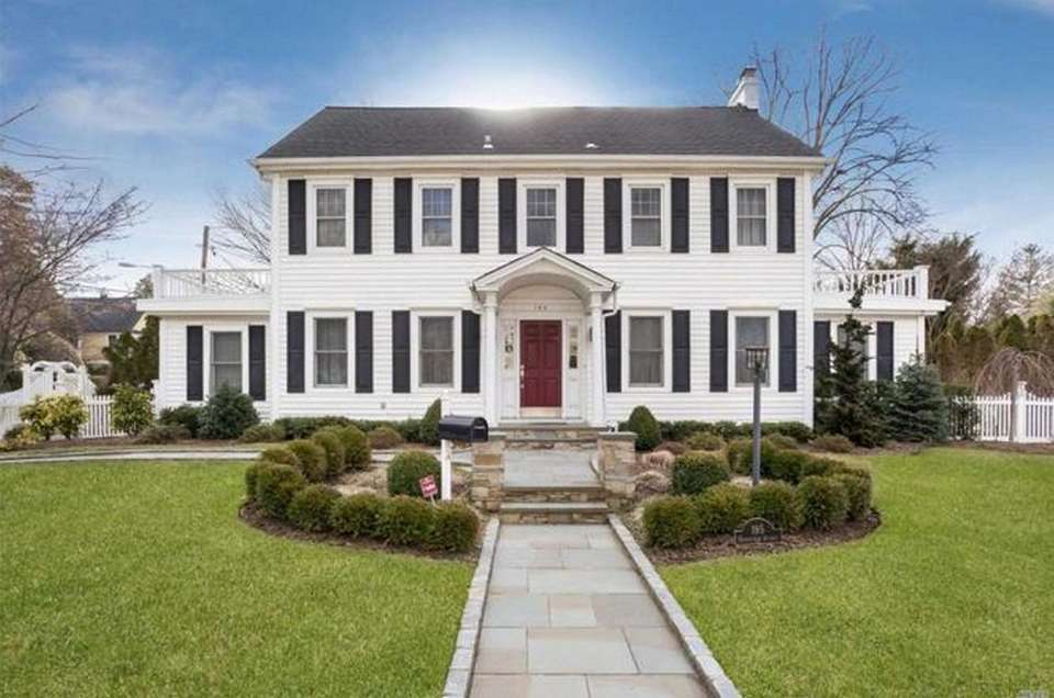 This Rockville Centre Colonial includes four bedrooms and