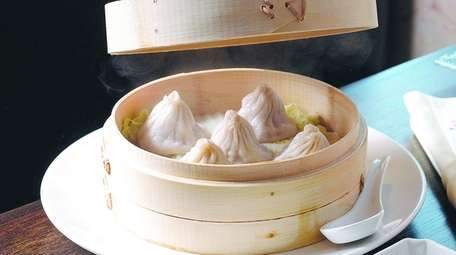 Juicy soup dumplings filled with pork and gingery