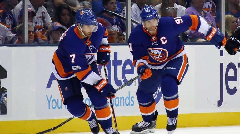 New York Islanders skate against the Philadelphia Flyers