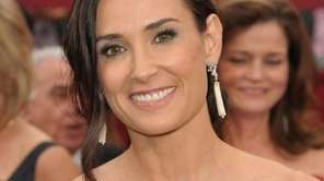 Actress Demi Moore arrives for the 82nd Academy