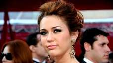 Singer/actress Miley Cyrus arrives at the 82nd Annual