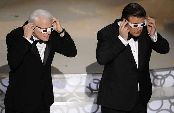 Host Alec Baldwin, right, and Steve Martin are