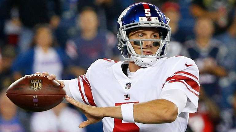 Giants quarterback Davis Webb looks to pass during