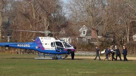 Suffolk County police patrol officers airlift a victim