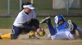 Jenna Laird of East Meadow, right, successfully steals