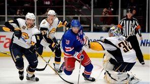 Buffalo Sabres goalie Ryan Miller stops a shot