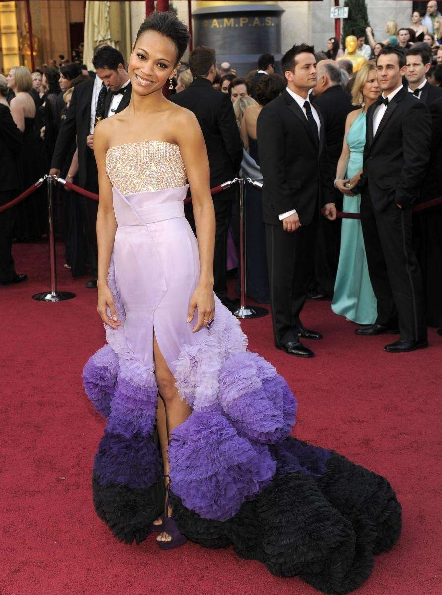 Zoe Saldana arrives wearing a gown by Riccardo
