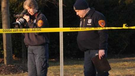 Investigators arrive at the scene of fatal hit-and-run