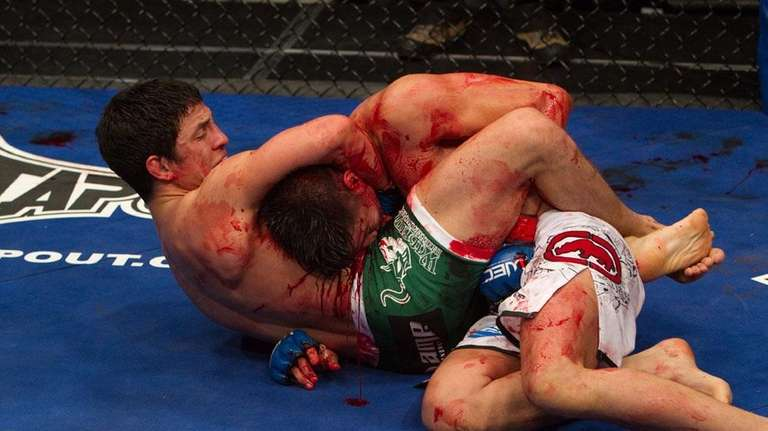 Joseph Benavidez, left, locks in a guillotine choke