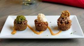 """The """"mofongo trio"""" includes grilled beef, garlic shrimp,"""