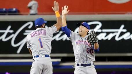 Mets shortstop Amed Rosario and outfielder Michael Conforto