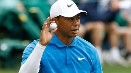 Tiger Woods reacts after his birdie on the
