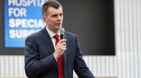 Nets owner Mikhail Prokhorov speaks during a press