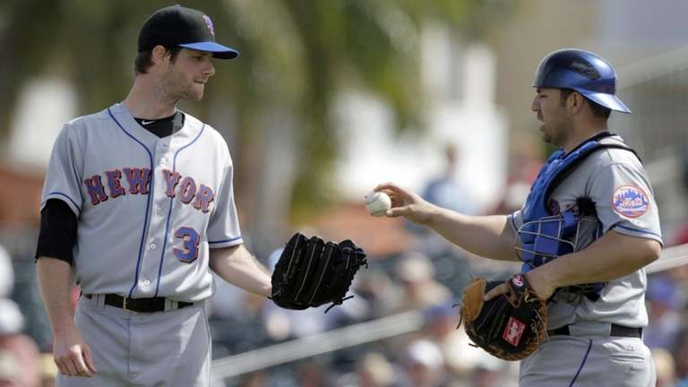 Mets catcher Rod Barajas, right, hands the ball