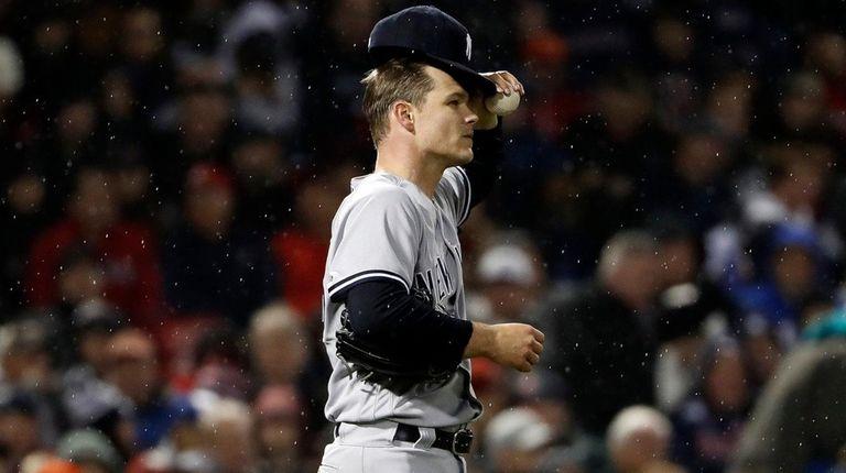 Yankees' Sonny Gray adjusts his cap after walking