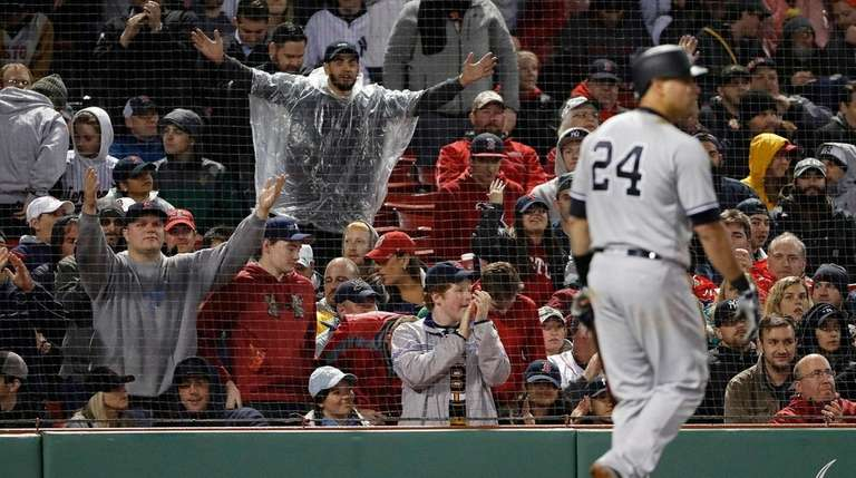 Red Sox fans cheer as the Yankees' Gary