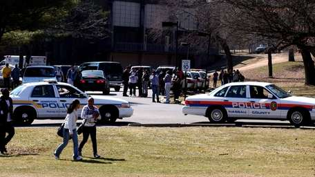 Police arrive at Hempstead High School after a