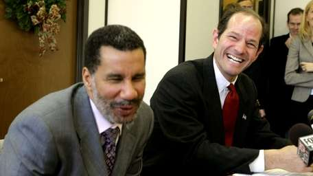 Eliot Spitzer, right, and David Paterson laugh as