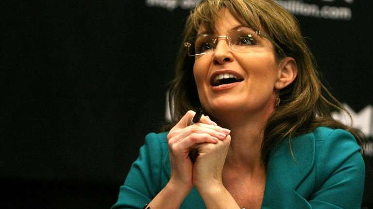 Former Alaska Gov. Sarah Palin greets fans during