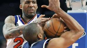 The Knicks' Wilson Chandler, left, ties up Atlanta's
