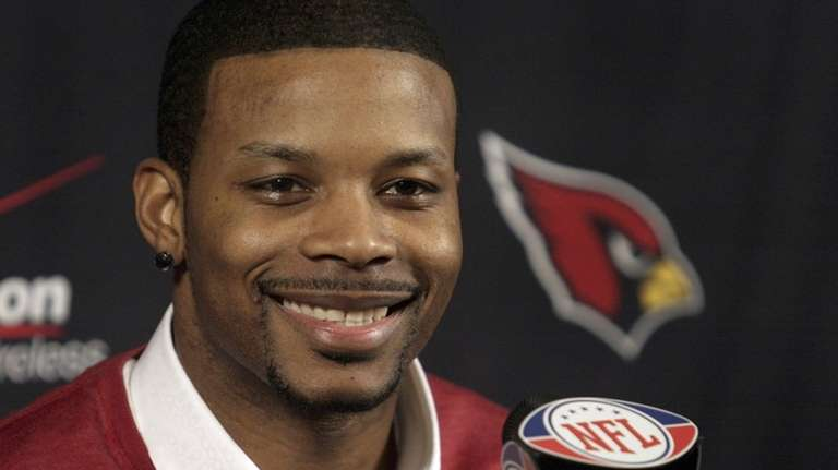 Former Jets safety Kerry Rhodes grins as he