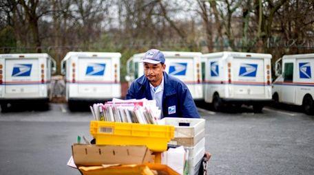 U.S. Postal Service letter carrier Michael McDonald makes