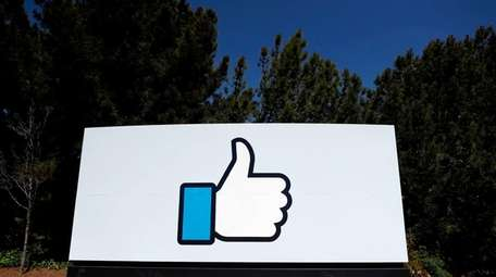 The Facebook logo at the company's headquarters in