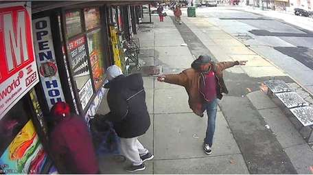 Saheed Vassell brandishes a metal object in surveillance