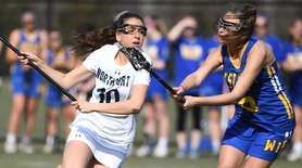 Northport midfielder Olivia CArner is defended by West