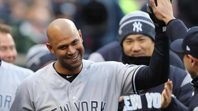 The Yankees' Aaron Hicks is congratulated in the