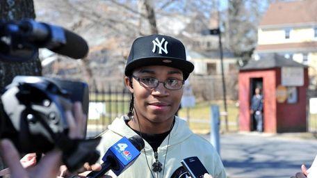 Hempstead High School student Jae'Vaughn Riddick, 17, talks