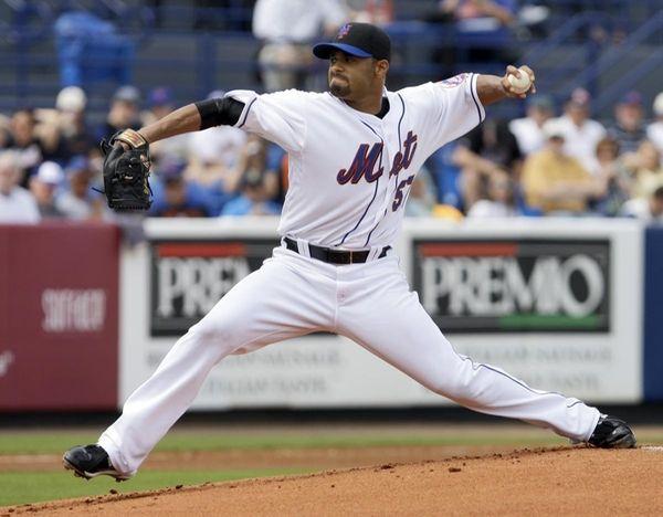 New York Mets starting pitcher Johan Santana throws