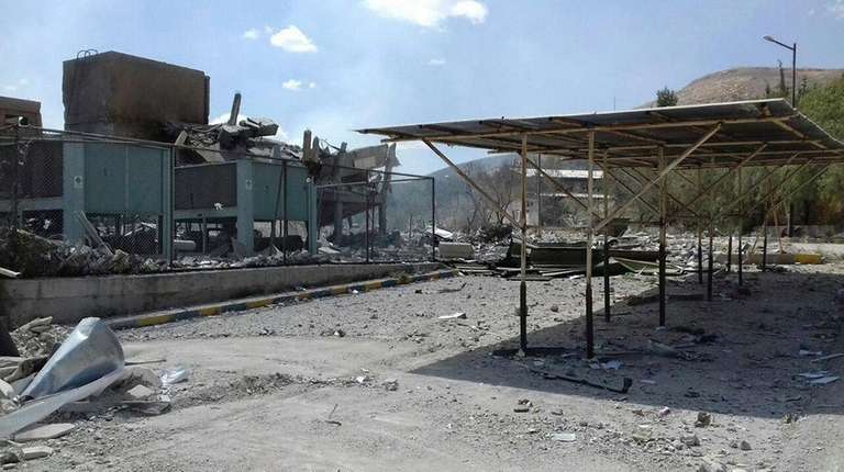 The Syrian Scientific Research Center is seen damaged