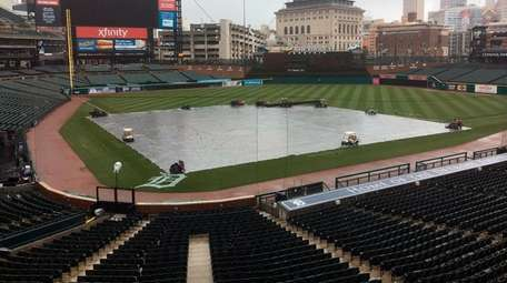 The field is covered as the Yankees and