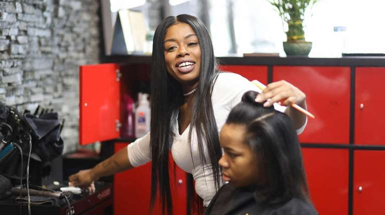 Hairstylist Shantelle Joseph works on Kael Melan of