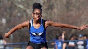 Courtashia Felton from Hempstead wins the girls 400-meter
