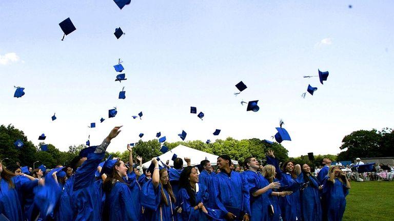 Herricks High School graduates throw their hats in