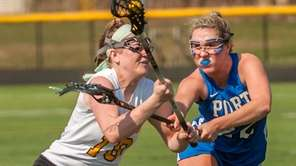 Wantagh's Kayla Conway, left, defends against Port Washington's