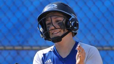 Heather Berberich, Calhoun shortstop, reacts after crossing home