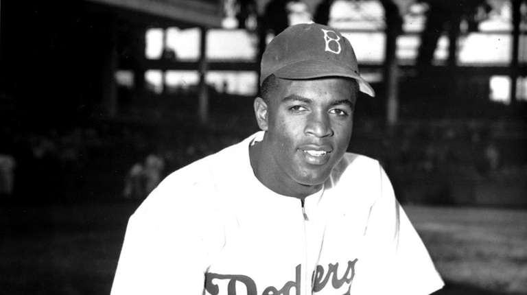 Jackie Robinson of the Brooklyn Dodgers poses at