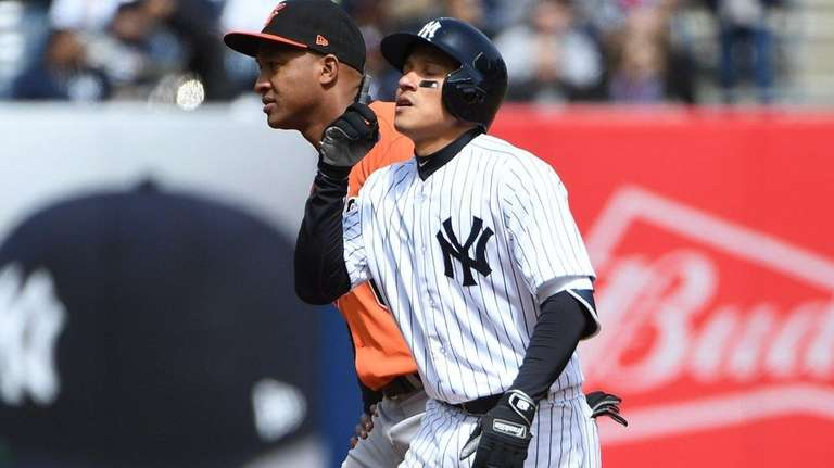 Yankees second baseman Ronald Torreyes reacts after his