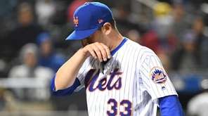 Mets starting pitcher Matt Harvey walks to the