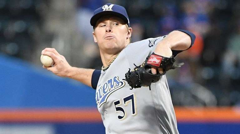 Brewers starting pitcher Chase Anderson delivers a pitch