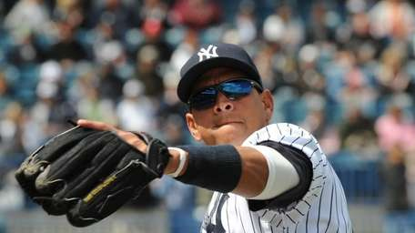 Alex Rodriguez warms up for play in the