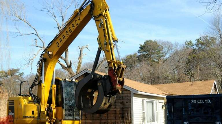 A Lake Ronkonkoma home is demolished, Wednesday. (March
