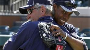 The Yankees' Curtis Granderson, right, hugs former manager