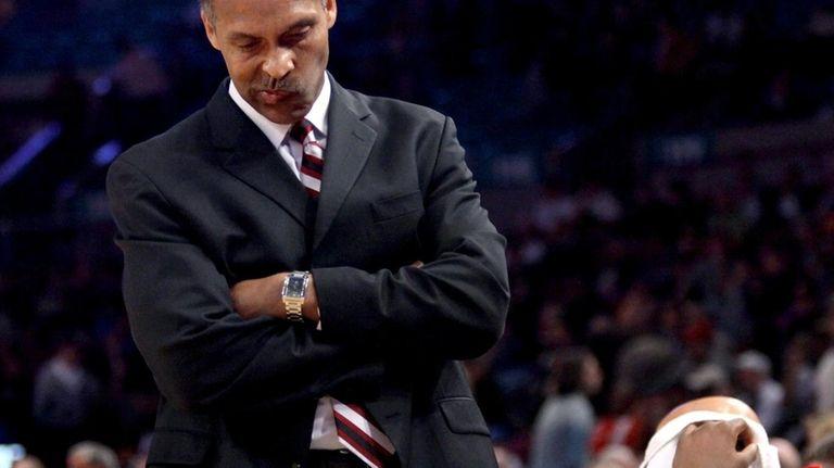 St. John's coach Norm Roberts hangs his head