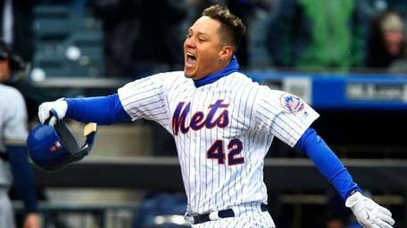 Wilmer Flores of the Mets celebrates his ninth
