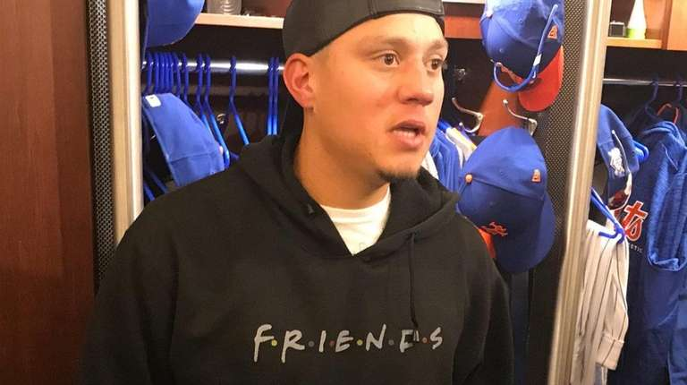 Mets infielder Wilmer Flores answers questions after hitting
