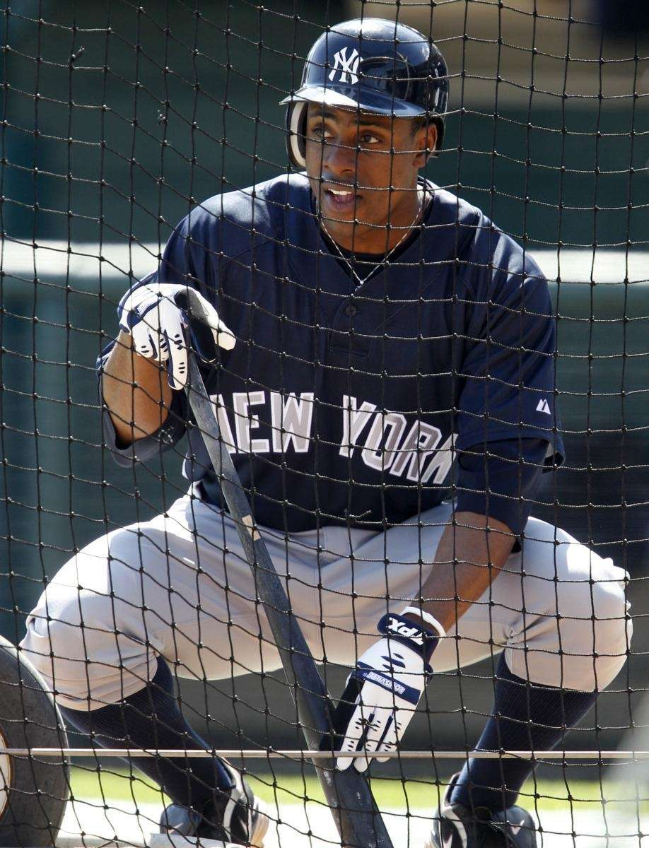 The Yankees' Curtis Granderson waits his turn in